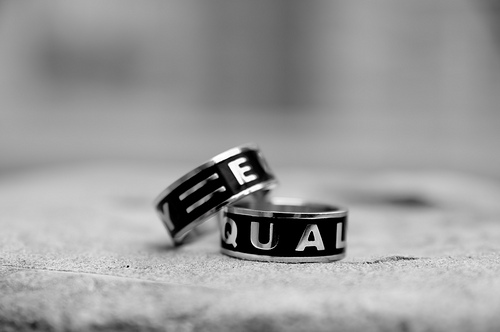 Two rings with the word equality on each
