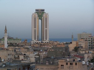 A tall tower with older buildings in the foreground in Tripoli, Libya.