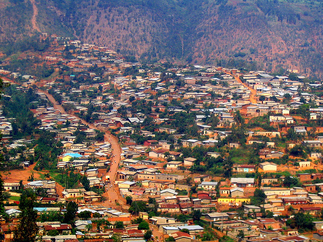 A hill in Kigali covered with houses.