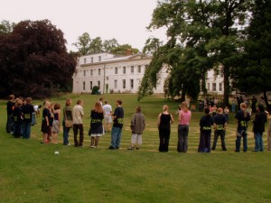People standing in a labyrinth cut into grass in the Woodbrooke garden