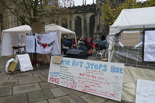 Tents and signs by Sheffield cathedral
