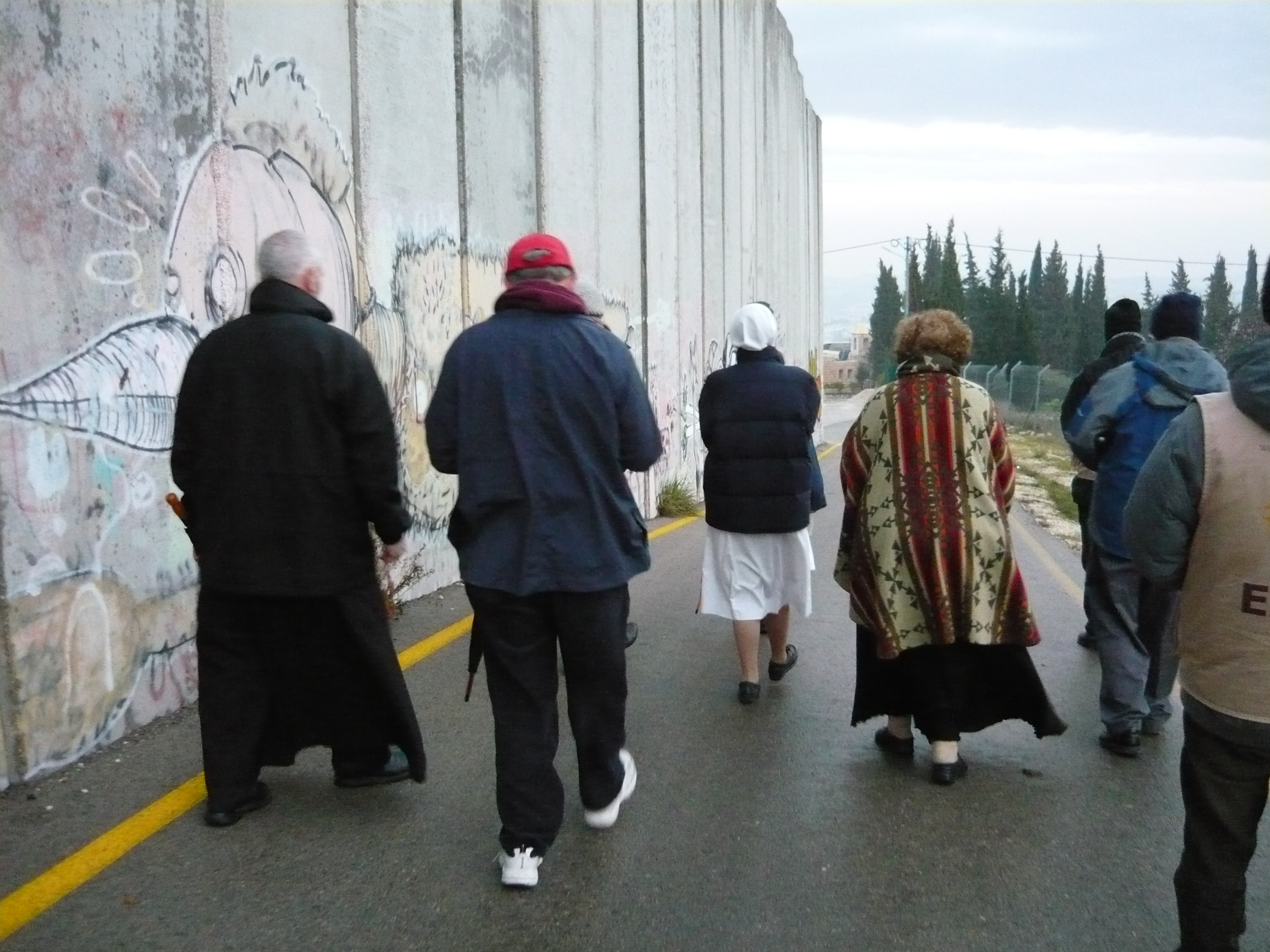 People of faith walking alongside the Separation Barrier