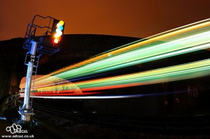 long exposure of two trains on a railway line at night.