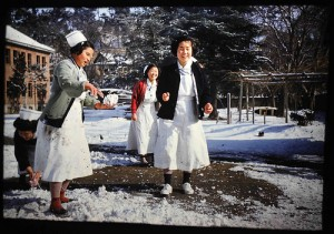 Korean nurses with snowballs.