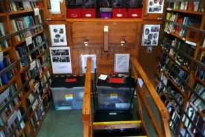 Inside view of the library, with books on shelves and steps pulled inside.