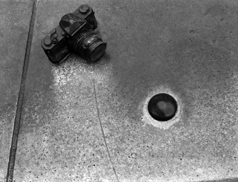 A camera on the floor pointed at a circle. Photo: Heather Martin