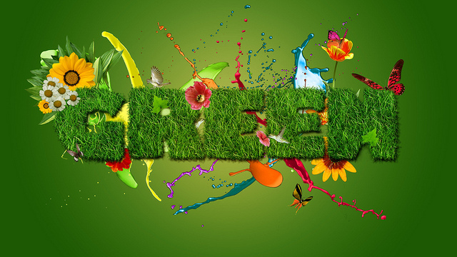 The letters of the word 'Green' looking like a hedge among a riot of colour