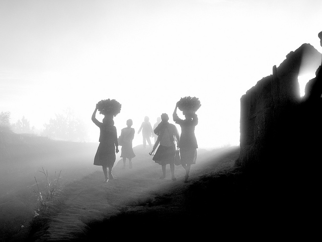 People in Madagascar walking in a mist