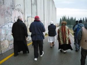 People of faith walking alongside the Separation Barrier