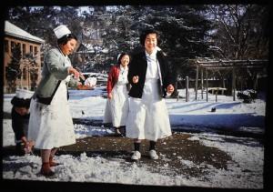 Korean nurses with snowballs.