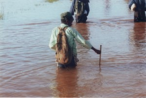 Children crossing flooded plains on their way to school. Photo: Money for Madagascar