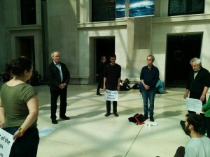 Quakers worshipping at the British Museum while holding placards.